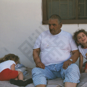 Ishak_Man with Two Girls-wm.jpg