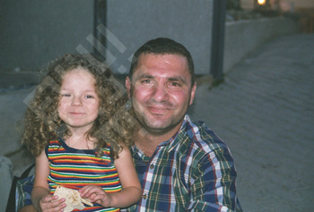 Ishak_Daughter with Relative-wm.jpg