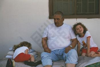 Ishak_Man with Two Girls-wm.jpg